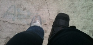 Sitting on my walker seat, waiting for a bus in my cam walker (i.e., the boot).